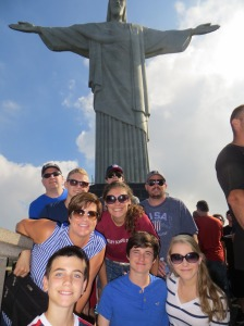 The group on the trip take a picture in front of Christ the Redeemer in Rio.