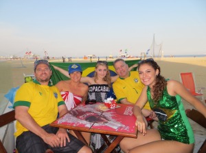 Family friends show their Brazilian pride on the beach.