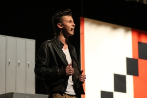 Sophomore Jack Glover, acting as Danny, performs during the Thursday night performance of Grease.