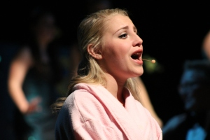 Senior Amanda Burrell, portraying Sandy, performs during the Thursday night performance of Grease.