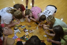A team counts change during the scavenger hunt while at the All Nighter.