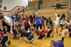 "Students do the ""man overboard"" pose during a game of Ships & Sailors at the All Nighter."