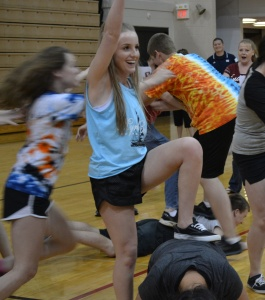 "Junior Micaiah Shockney does the ""man overboard"" pose during a game of Ships & Sailors."