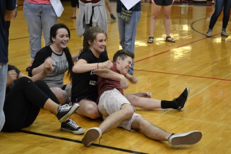 "(Left to Right): Madison Temple, Melea Shockney & Jack Gooldy do the ""Three Men Rowing"" pose during a game of Ships and Sailors."