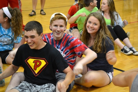 "Sophomore Connor Morton and Seniors Ethan Gomes and Emily Maegerlin do the ""three men rowing"" pose at the All Nighter."