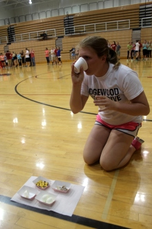 Sophomore Karlee Bland drinks the tomato juice with m&m's during the food relay.