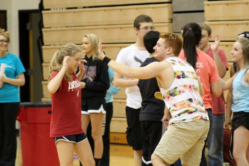 Junior Ben Nichols chases Junior Hannah Sears with his mustard-covered hand after the food relay.